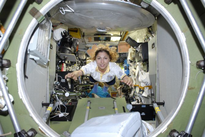 """Ansari flies weightlessly aboard the International Space Station. During her galactic travels, Ansair said she remembers watching a lightning storm while listening to music on her iPod. """"It was like it was playing to my music,"""" she said. """"It felt like gods are playing, making things happen."""""""