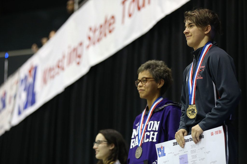 Euless Trinity's Mack Beggs (far right), a transgender male, stands at the podium after winning the class 6A 110-pound state title at the UIL Wrestling State Championship tournament at the Berry Center in Cypress, Texas on Saturday, Feb. 24, 2018. Biggs won the state championship title. (Rose Baca/The Dallas Morning News)