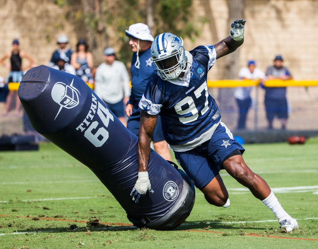 Dallas Cowboys defensive end Taco Charlton (97) runs a drill during an afternoon practice at training camp in Oxnard, California on Sunday, July 28, 2019. (Ashley Landis/The Dallas Morning News)