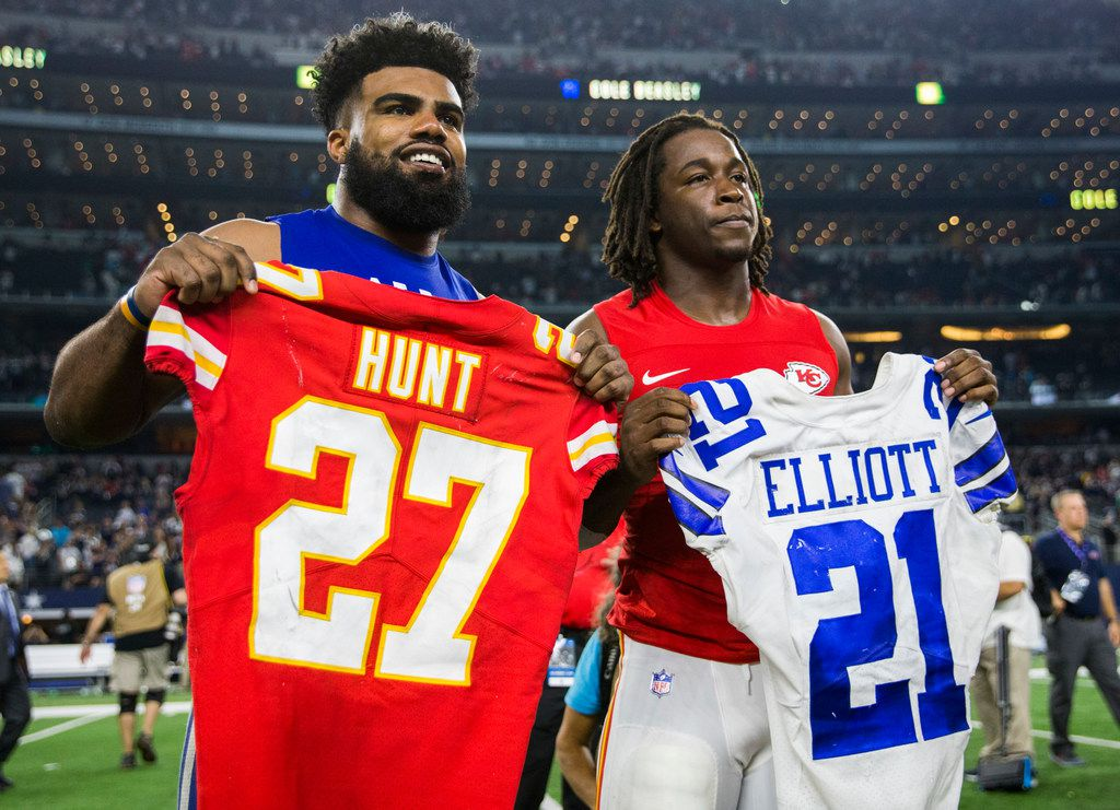 Dallas Cowboys running back Ezekiel Elliott (21) and Kansas City Chiefs running back Kareem Hunt (27) trade jerseys after an NFL game between the Dallas Cowboys and the Kansas City Chiefs on Sunday, November 5, 2017 at AT&T Stadium in Arlington, Texas. Cowboys won 28-17. (Ashley Landis/The Dallas Morning News)