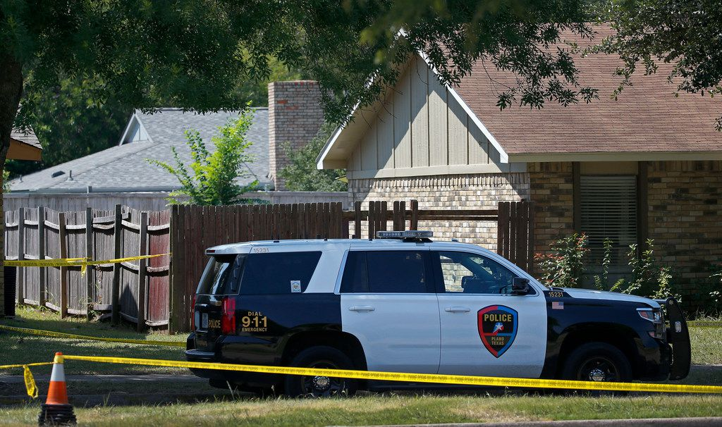 A Plano police officer secures a home on West Spring Creek Parkway where Spencer James Hight killed eight people.