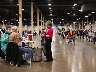 People wait to receive the COVID-19 vaccine at Fair Park in Dallas on Thursday, Jan. 14, 2021. A limited number of COVID-19 vaccine shots will be available Thursday at Fair Park for North Texans 75 and older. (Juan Figueroa/ The Dallas Morning News)