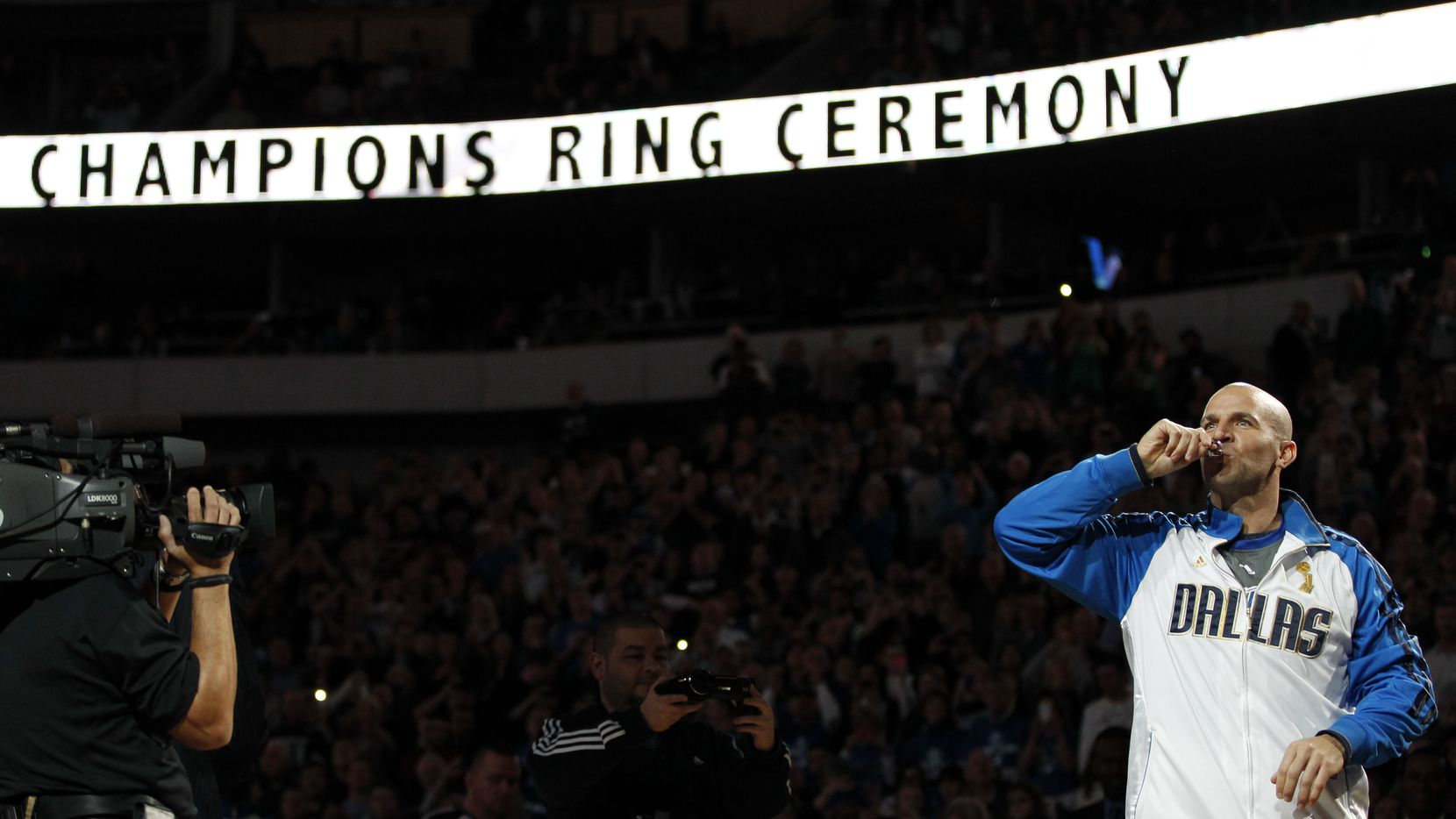Dallas Mavericks point guard Jason Kidd (2) kisses his NBA championship ring during the ring ceremony at the American Airlines Center in Dallas on January 25, 2012.