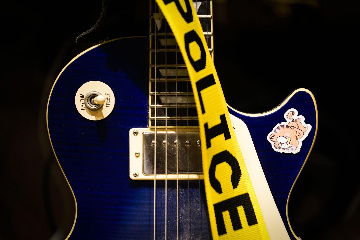 A Garfield sticker is seen on Korbin Bilbrey's electric guitar on Thursday, June 17, 2021, in Dallas.