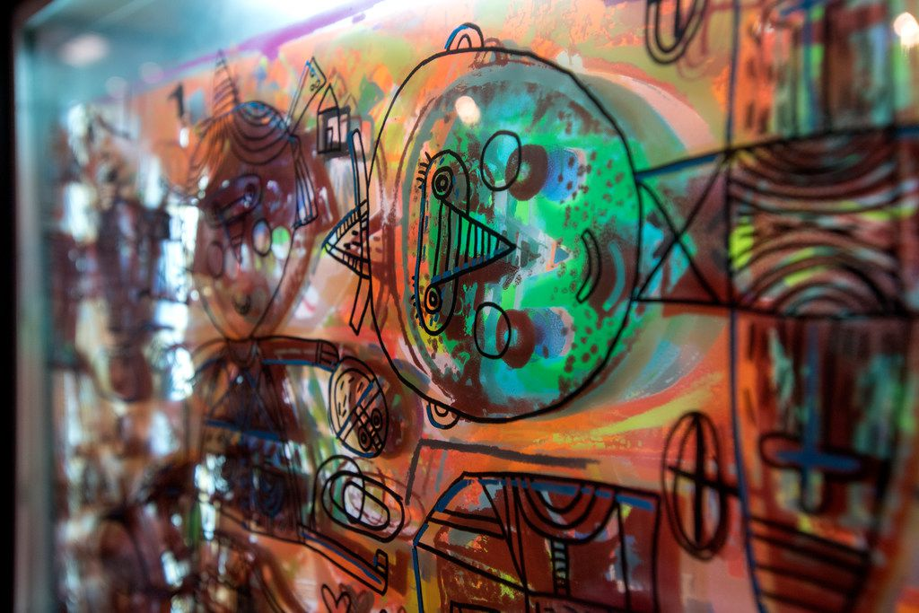 A work of art by Oaxacan artist Fernando Andriacci, which features painting and drawing on layered glass.