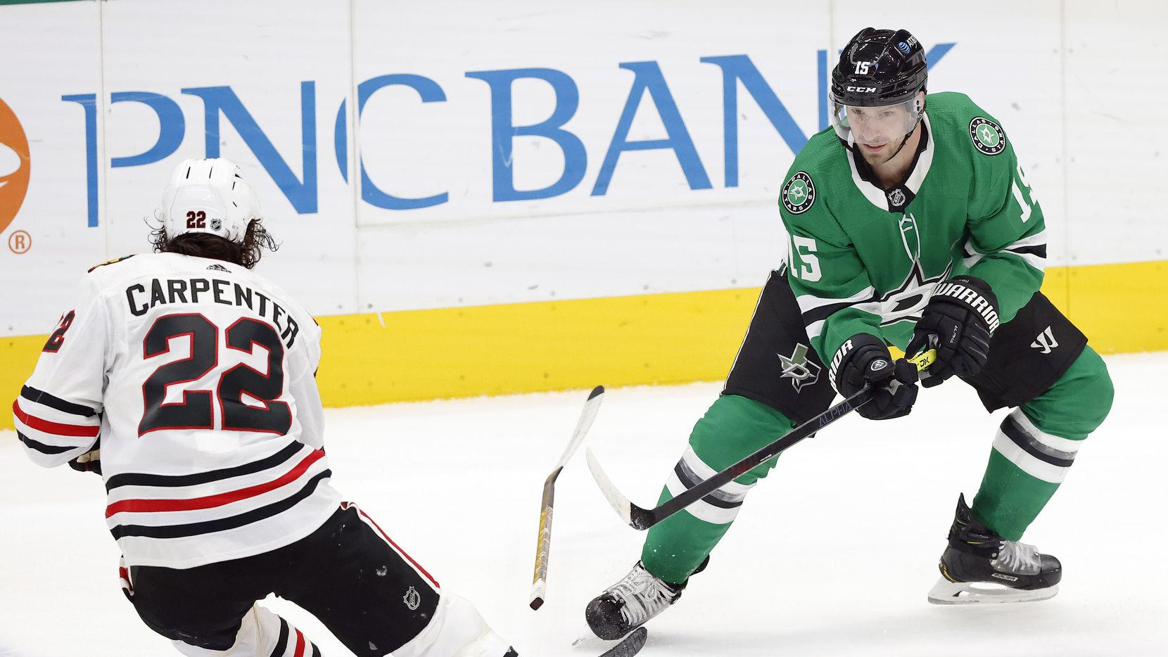 Chicago Blackhawks center Ryan Carpenter (22) loses his stick as Dallas Stars defenseman Mark Pysyk (13) steals the puck during the first period at the American Airlines Center in Dallas, Tuesday, March 9, 2021.