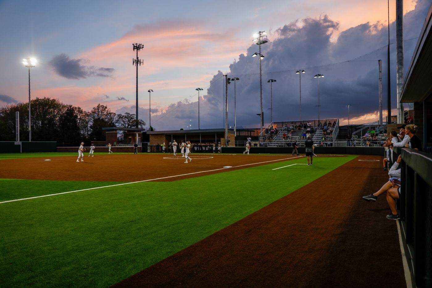 The sun sets during a nondistrict high school softball game between Denton Guyer and Keller in Denton on Tuesday, March 30, 2021. (Juan Figueroa/ The Dallas Morning News)