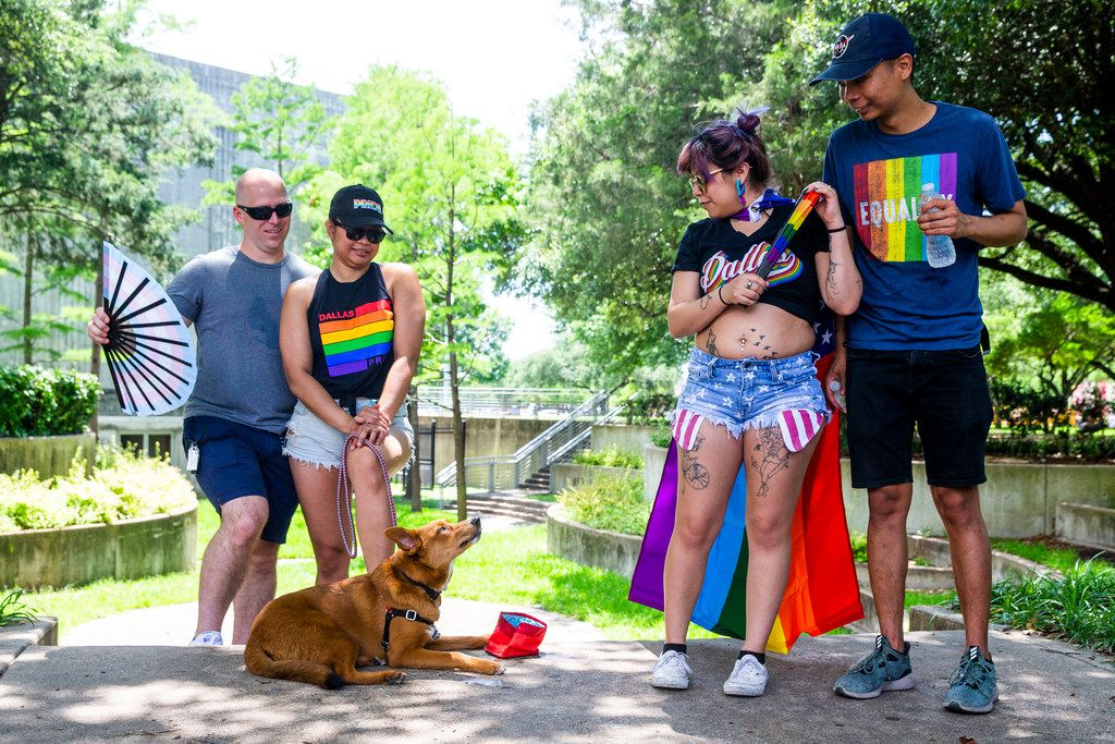 Kevin Mauter, left, watches his dog, Zeus, along with Genesis Gavino, second left, as they are joined by Monica Hernandez and Earvin Gavino, right, during the annual Dallas Pride / Alan Ross Texas Freedom Parade at Fair Park in Dallas on Sunday, June 2, 2019. (Shaban Athuman/Staff Photographer)