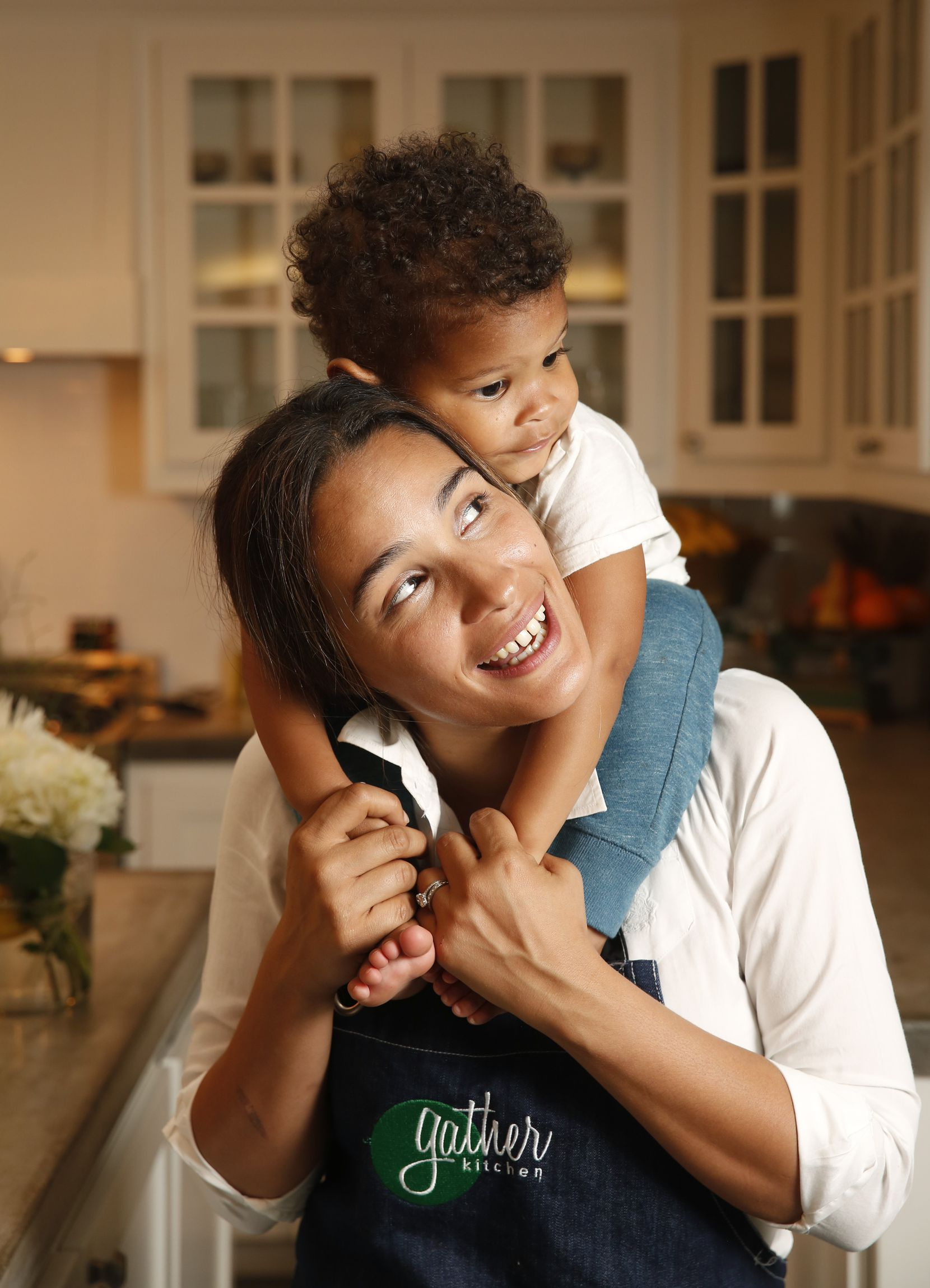 Chef Soraya Spencer, owner of Gather Kitchen, with her son Ethan Zeine at their home in Dallas.