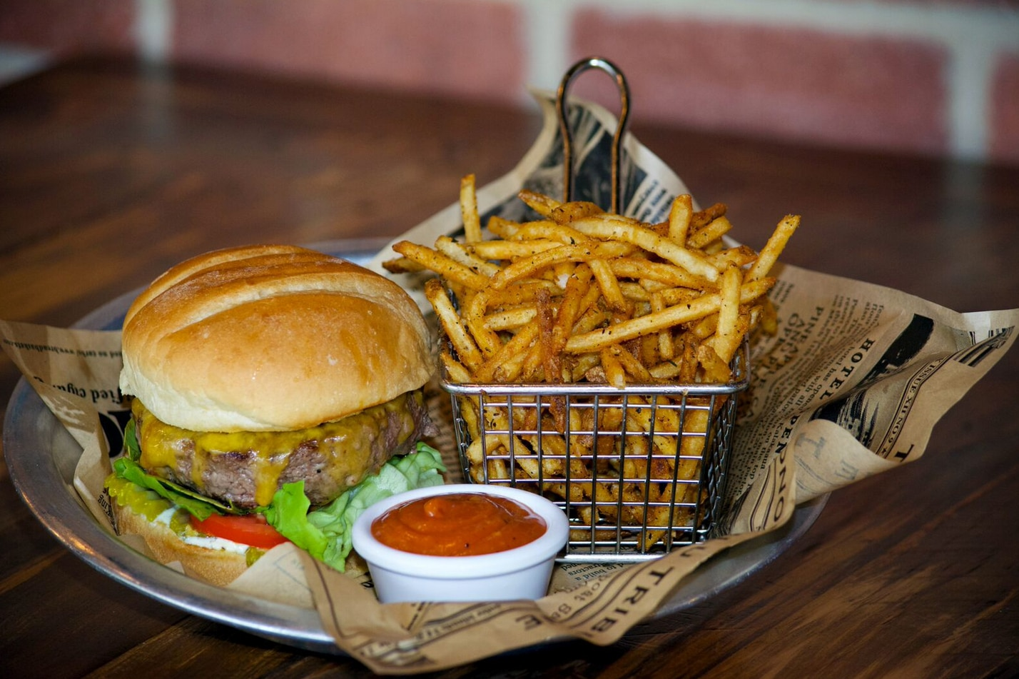 The cheeseburger is made with Akaushi beef and topped with a bun from Village Baking Co. in Dallas.