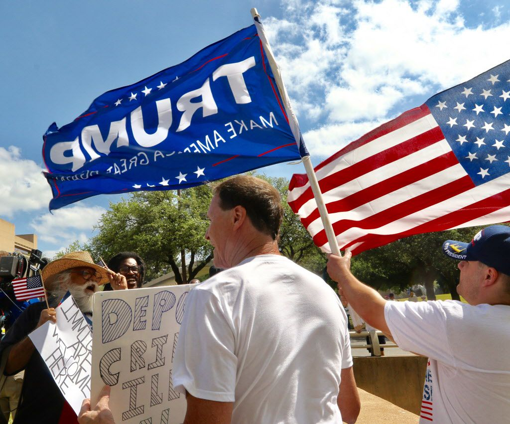Casa Gaytan, left, debates with Trump supporters Rocky C Beaudreau, during the Dallas Mega March on Sunday, April 9, 2017 in downtown Dallas.