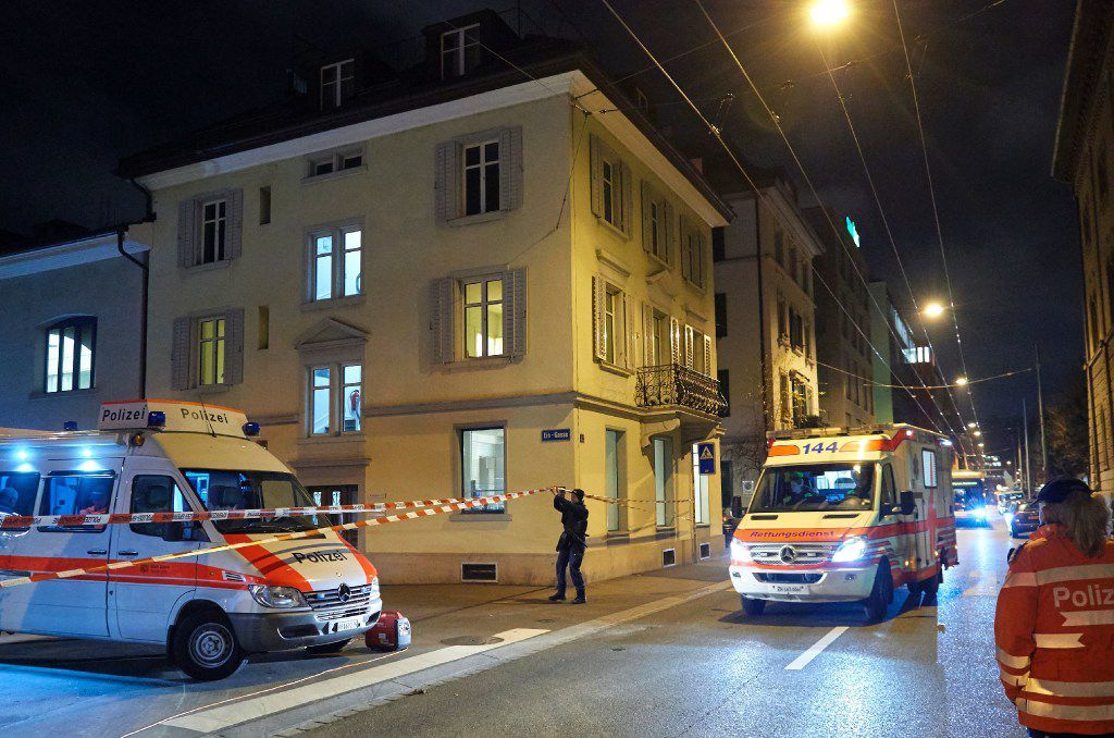 Ambulance and police cars are seen outside a Muslim prayer hall, central Zurich, on December 19, 2016, after three people were injured by gunfire.