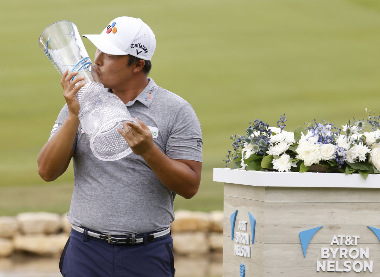 Kyoung-Hoon Lee kisses the trophy after winning the AT&T Byron Nelson at TPC Craig Ranch on Saturday, May 16, 2021 in McKinney, Texas. (Vernon Bryant/The Dallas Morning News)