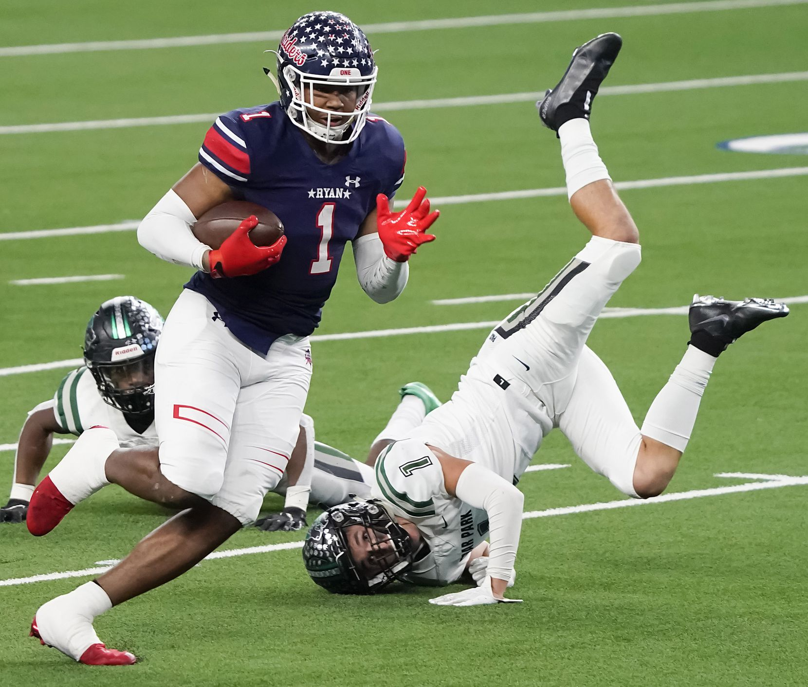Denton Ryan wide receiver Ja'Tavion Sanders (1) tests past Cedar Park defensive back Cody Marshall gets past during the first half of the Class 5A Division I state football championship game at AT&T Stadium on Friday, Jan. 15, 2021, in Arlington, Texas. (Smiley N. Pool/The Dallas Morning News)