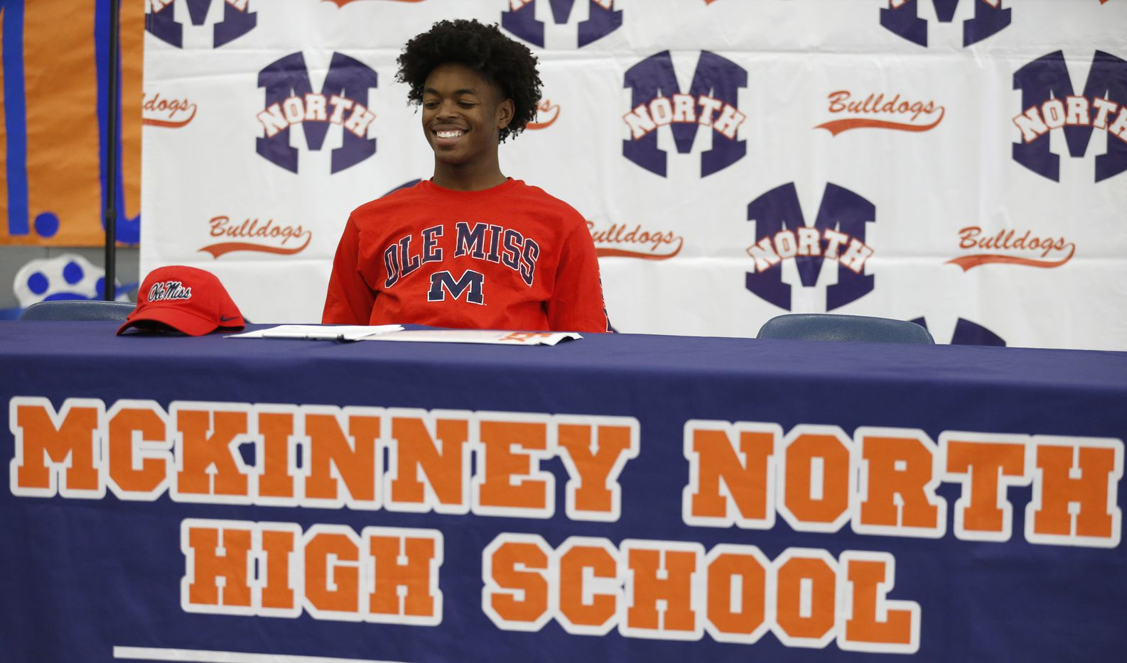McKinney North wide receiver J.J. Henry is all smiles as he prepares to sign his letter of intent to play for the University of Mississippi during a signing day ceremony at McKinney North High School on Wednesday, December 16, 2020 in McKinney, Texas. (Vernon Bryant/The Dallas Morning News)