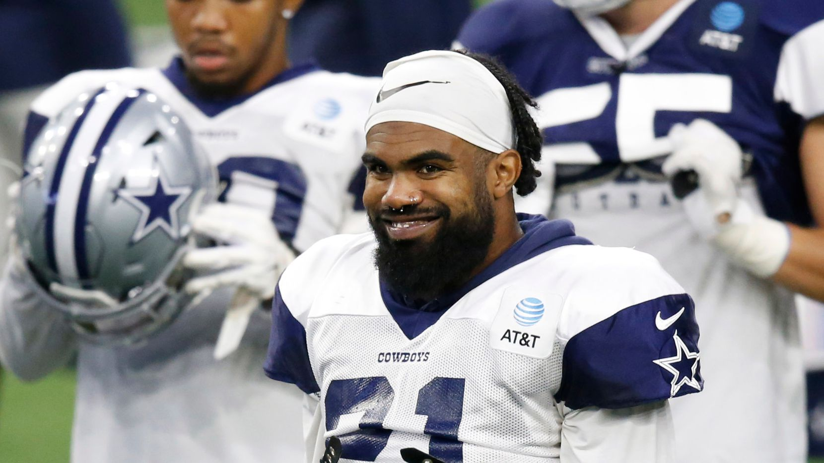 Dallas Cowboys running back Ezekiel Elliott (21) smiles during training camp at the Dallas Cowboys headquarters at The Star in Frisco, Texas on Monday, August 17, 2020.