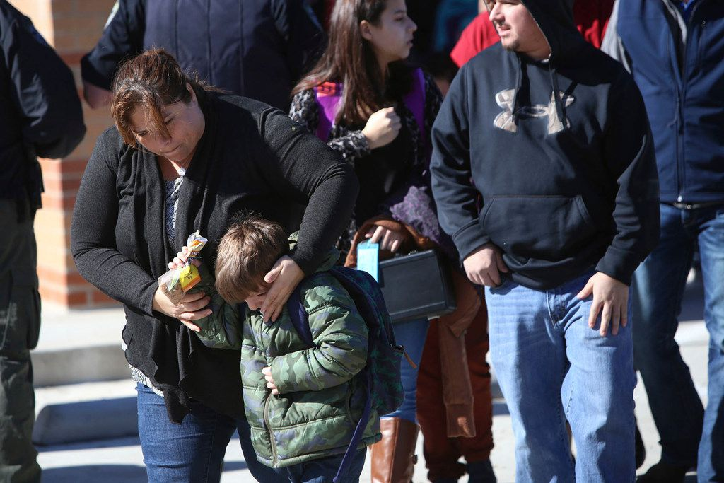 Parents pick up their children at Stafford Elementary school after a shooting at Italy High School on Monday.