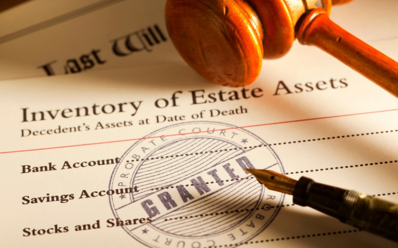 Anytime a specific bequest is made, it should always be accompanied by a statement about who is responsible for paying any associated debt.