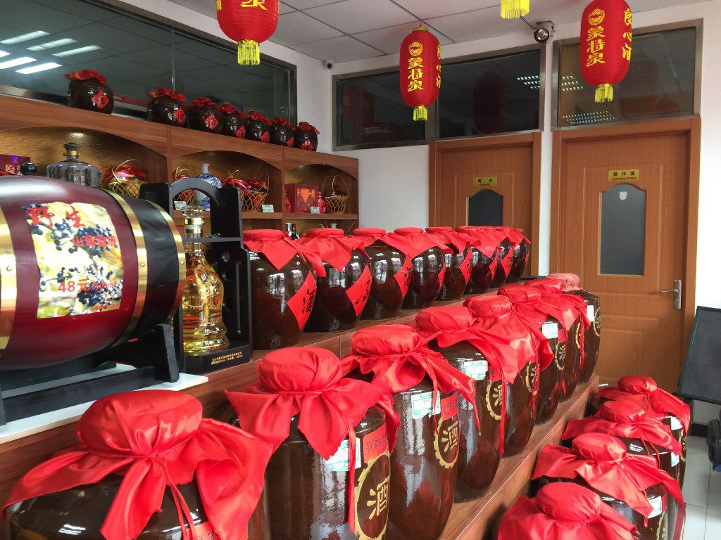 At the Mengtequan Aged Wine store, medicinal wine in large vats hold center stage. Chinese have long believed in the curative properties of wine for drinking and rubbing on the body.