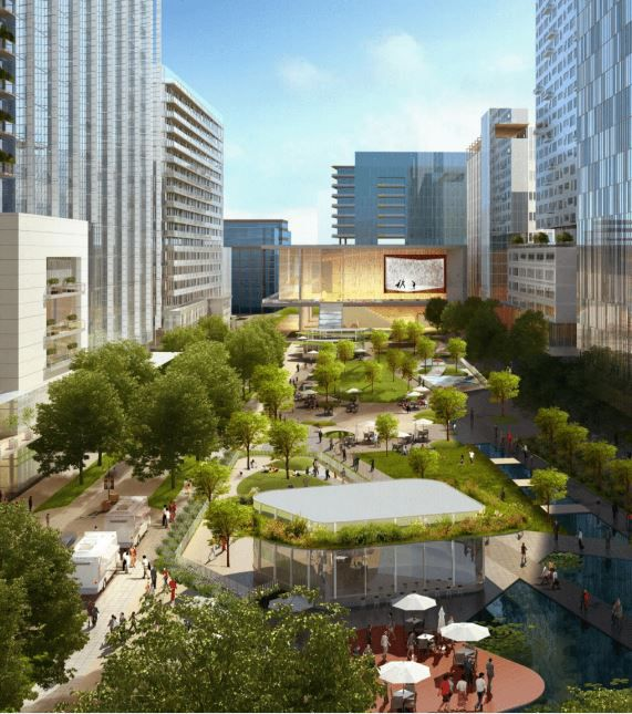This rendering shows an updated Hall Park with green space between buildings that ends with a long-sought-after performing arts hall in Frisco.