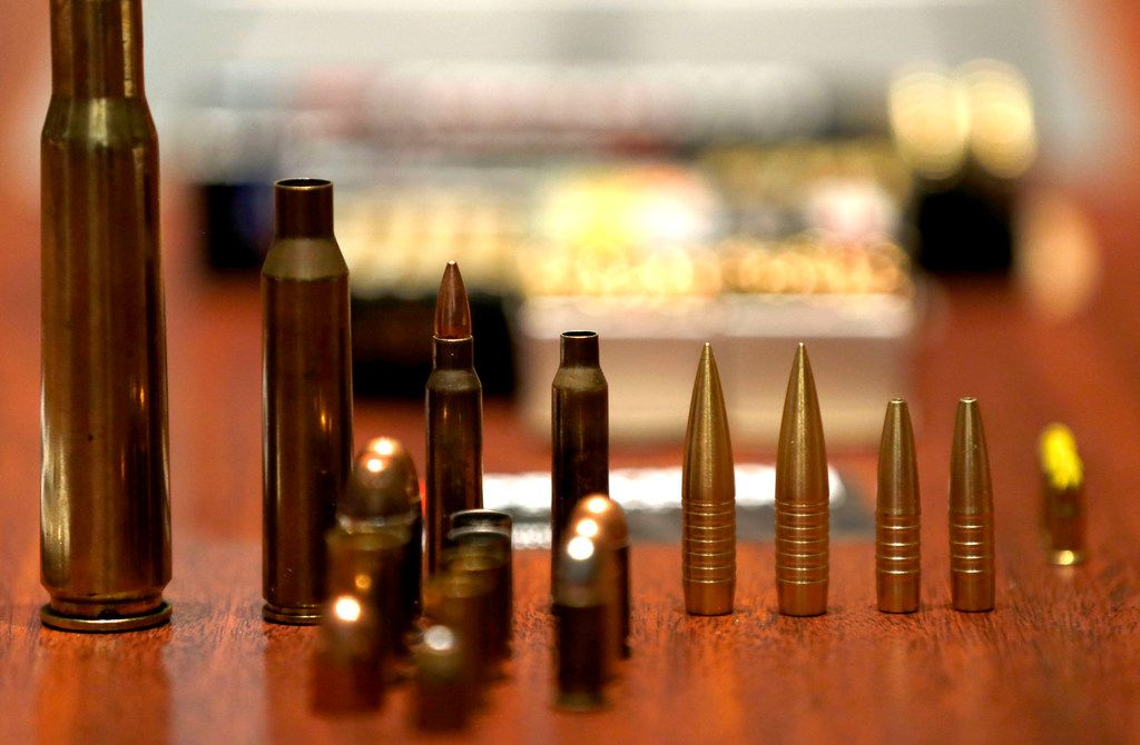Samples of ammunition that American Precision Ammunition makes sit on the table during an interview with co-owner Gary Phillips at the company's office in Mineral Wells.