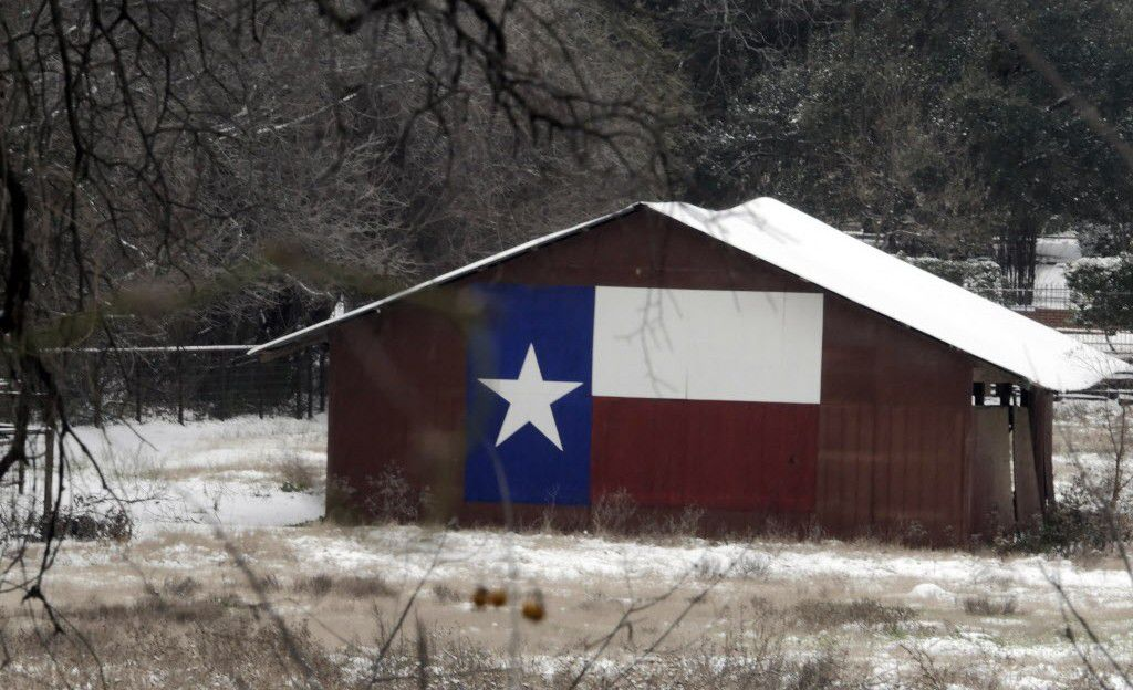 The Texas flag adorns a barn in southern Arlington. (2015 File Photo/Ron Baselice)