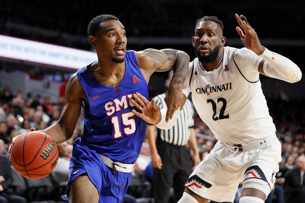 SMU's Isiaha Mike (15) drives against Cincinnati's Eliel Nsoseme (22) during the second half of an NCAA college basketball game Saturday, Feb. 2, 2019, in Cincinnati. (AP Photo/John Minchillo)