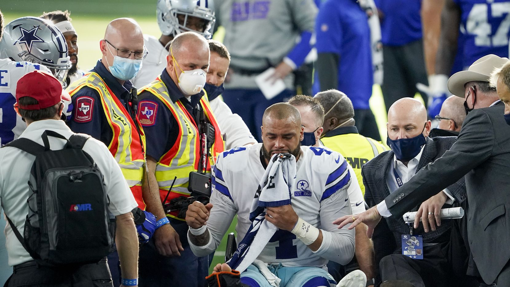 Dallas Cowboys quarterback Dak Prescott leaves the field on a cart after beig injured on a tackle by New York Giants cornerback Logan Ryan during the third quarter of an NFL football game at AT&T Stadium on Sunday, Oct. 11, 2020, in Arlington. Prescott was injured o the play when Ryan came down on his right leg and left the game.