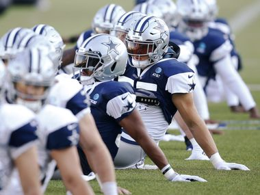 Dallas Cowboys linebacker Leighton Vander Esch (55) stretches with teammates in practice during training camp at the Dallas Cowboys headquarters at The Star in Frisco, Texas on Thursday, August 20, 2020.