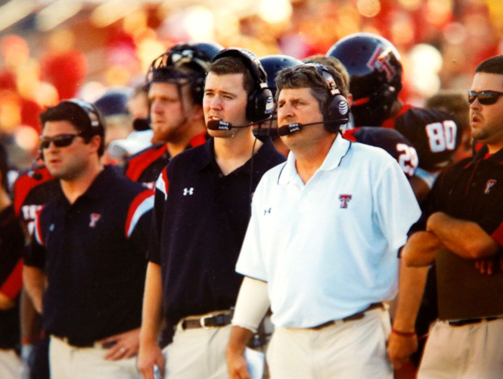 Texas Tech student assistant Lincoln Riley is pictured here (center, left) with head coach Mike Leach (white shirt) who gave him his start in coaching. The former Muleshoe Mules quarterback was a walk-on at Texas Tech where he shortly became a student assistant. He currently is is the head football coach for the Oklahoma Sooners. (courtesy of Marilyn and Mike Riley)