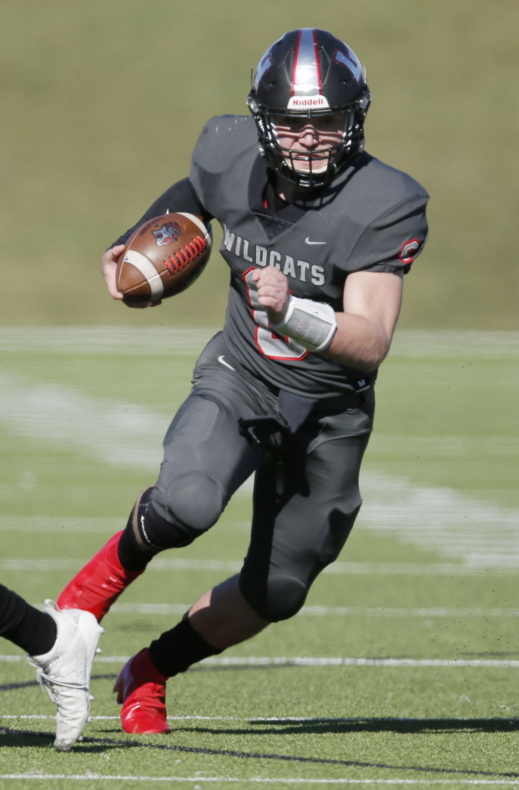TXHSFB Lake Highlands senior quarterback Mitch Coulson (6) carries the ball during the first half of a high school playoff football game against Richardson at Wildcat-Ram Stadium in Dallas, Wednesday, November 25, 2020. (Brandon Wade/Special Contributor)