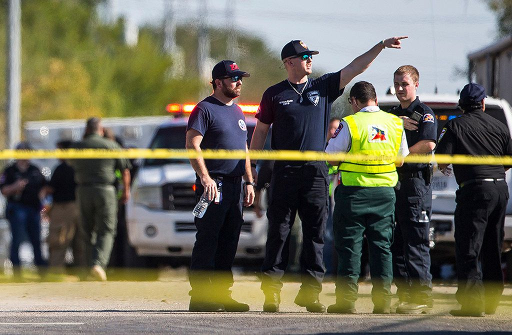 Law enforcement officials work the scene of a fatal shooting at First Baptist Church in Sutherland Springs on Sunday, Nov. 5, 2017.