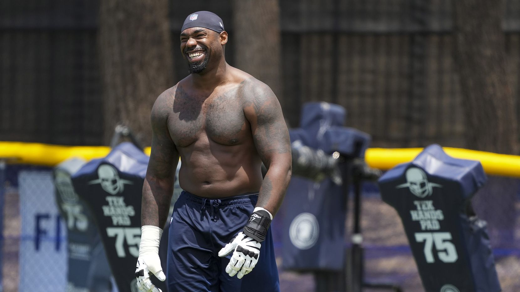 Dallas Cowboys tackle Tyron Smith smiles as he leaves the field following the first practice of the team's training camp on Thursday, July 22, 2021, in Oxnard, Calif.