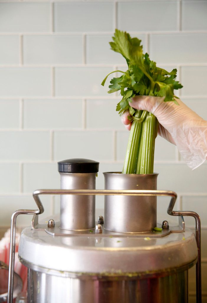 Celery is put inside a juicer at The GEM in Dallas