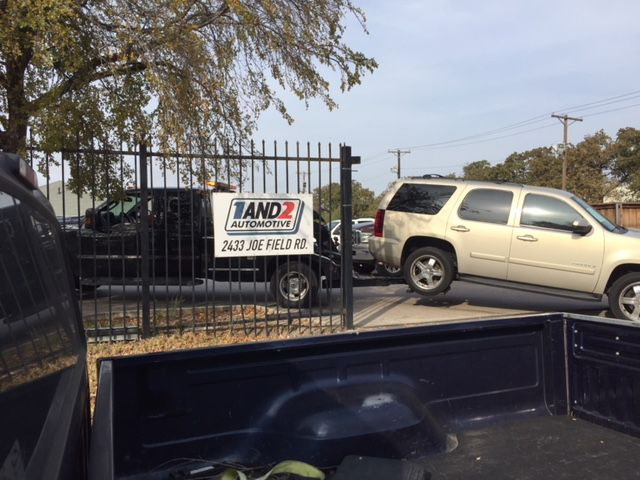 "A car is towed into 1and2 Automotive, a common sight at the ""Buy here, pay here"" auto dealer in northwest Dallas."