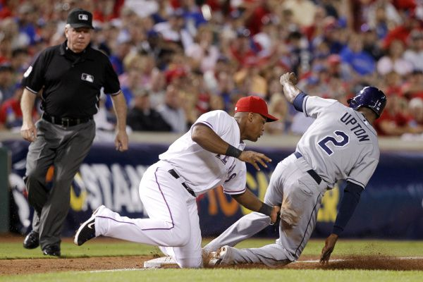 Rangers third baseman Adrian Beltre tags out Tampa Bay's B.J. Upton, who was trying to steal third in the fifth inning. Mike Napoli gunned down Upton.