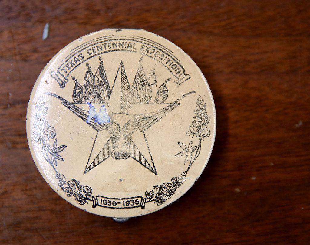 A makeup compact from the Texas Centennial Exposition in 1936.