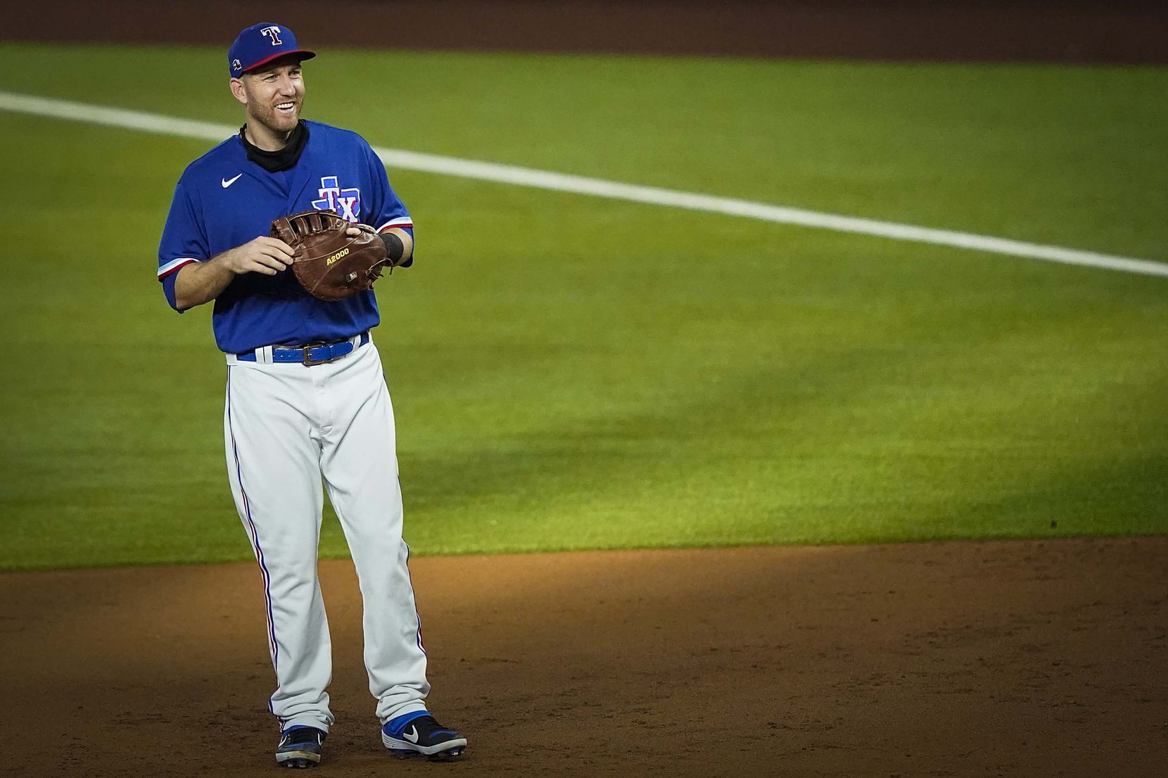 Texas Rangers infielder Todd Frazier plays first base during the third inning of an exhibition game against the Colorado Rockies at Globe Life Field on Wednesday, July 22, 2020.