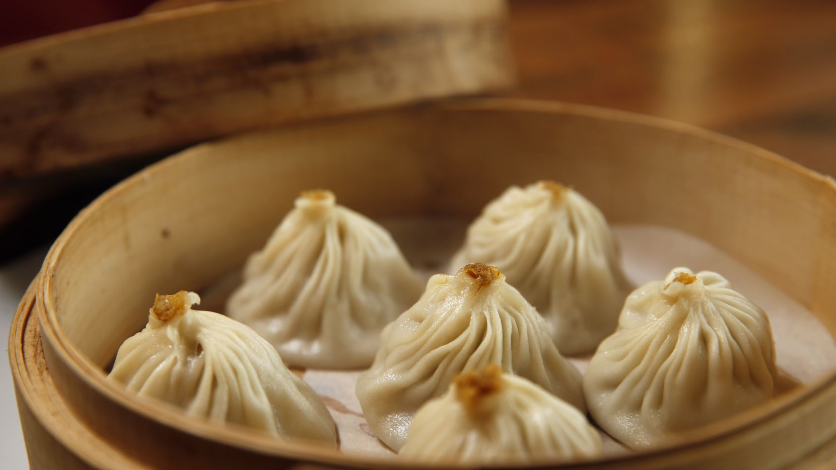 Steamed pork and crabmeat juicy dumplings — soup dumplings, or xiao long bao — are among 10 expertly made dumplings on the menu at Dragon House, a new Chinese restaurant in Southlake.