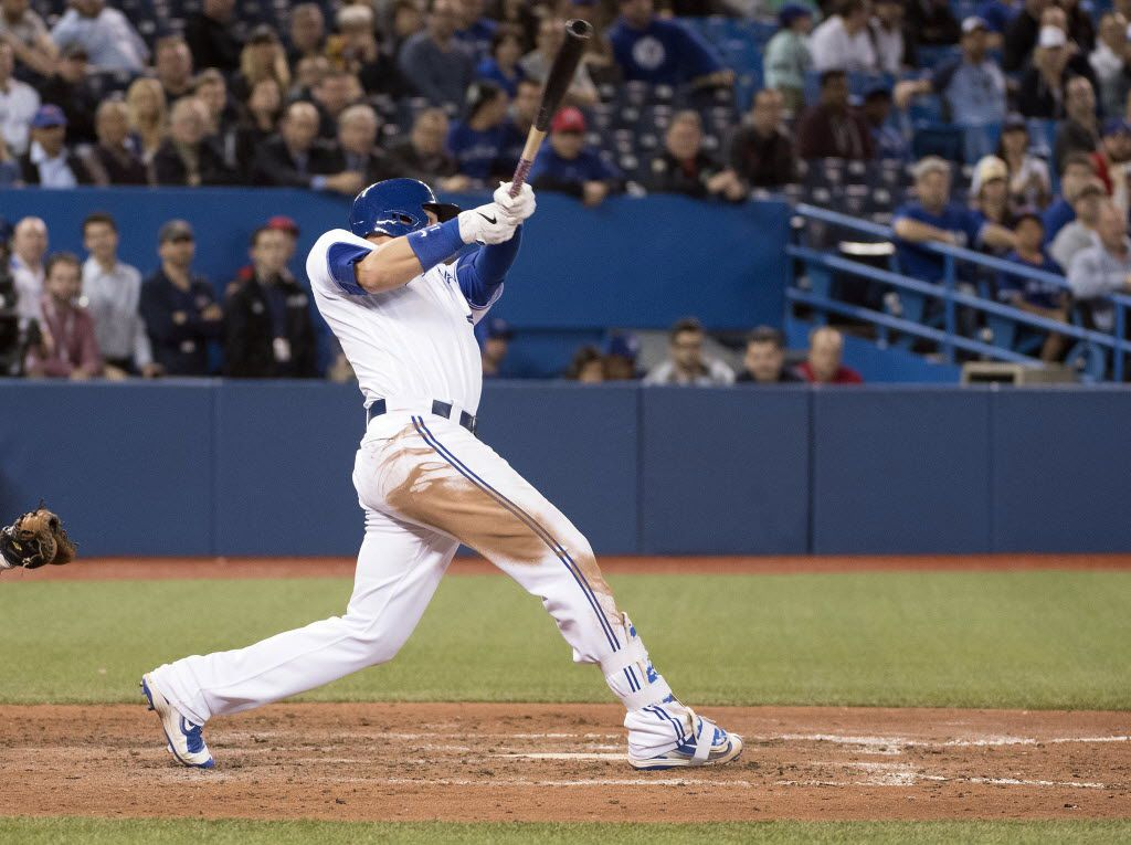 May 3, 2016; Toronto, Ontario, CAN; Toronto Blue Jays first baseman Justin Smoak (14) hits a home run during the ninth inning in a game against the Texas Rangers  at Rogers Centre. The Toronto Blue Jays won 3-1. Mandatory Credit: Nick Turchiaro-USA TODAY Sports ORG XMIT: USATSI-259042