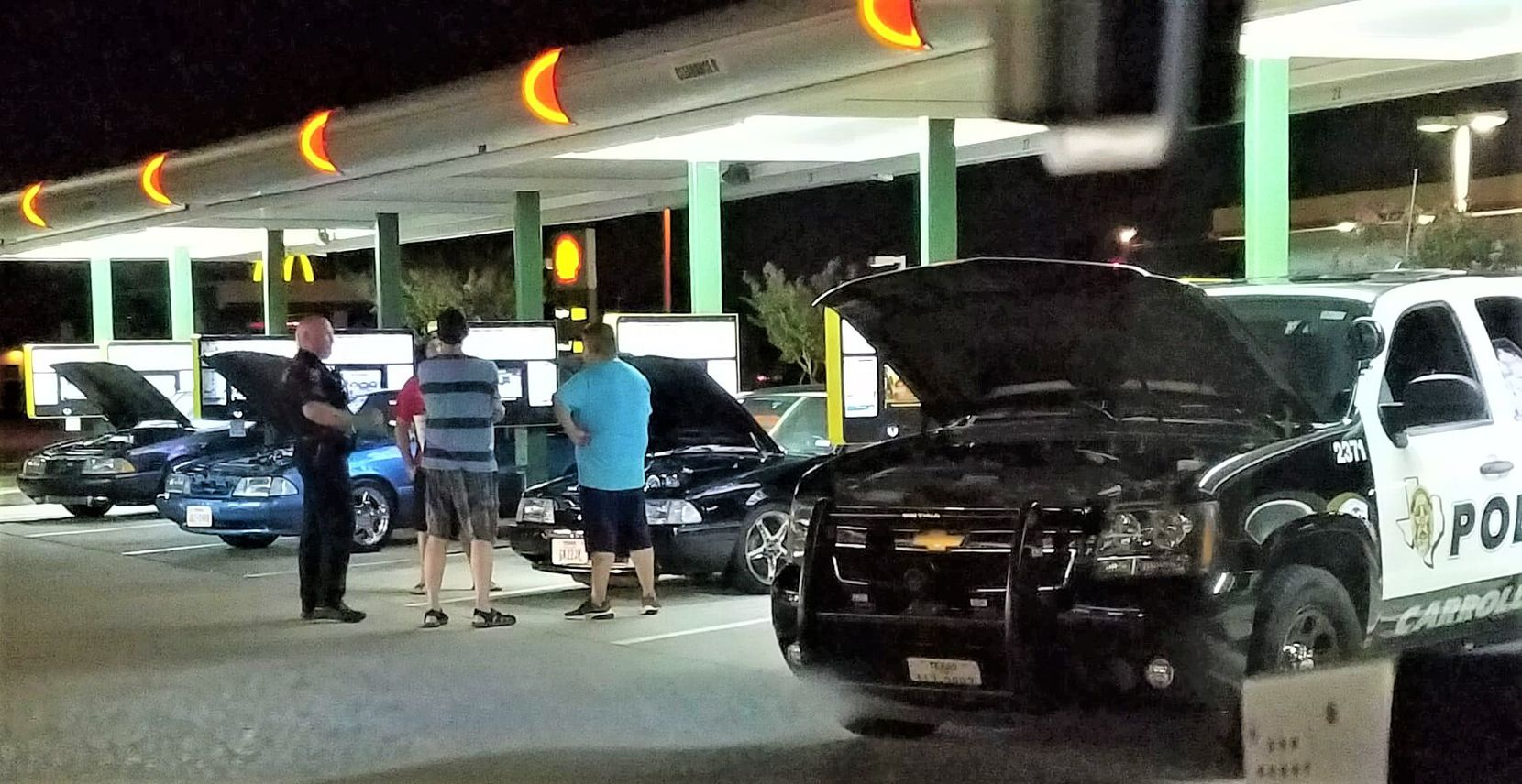 """Sgt. Allen Hollis """"was the kind of guy who would pull up to a Mustang meet-up in his squad car and casually pop the hood,"""" the Carrollton Police Department said."""