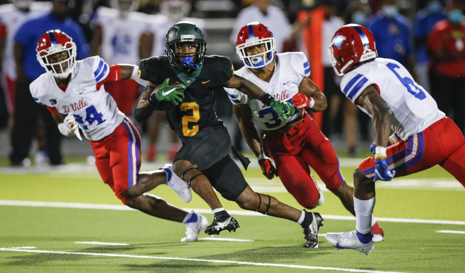 DeSoto senior wide receiver Mike Murphy (2) carries the ball against the Duncanville defense during the first half of a high school football game at DeSoto High School, Friday, September 17, 2021. (Brandon Wade/Special Contributor)