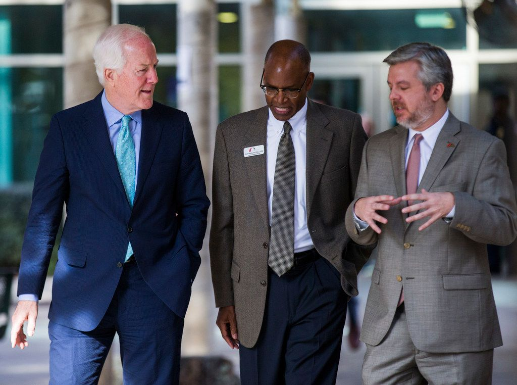 In this 2017 file photo, U.S. Sen. John Cornyn (left) toured The Bridge Homeless Recovery Center with Interim President and CEO of David Woody (center) and COO Sam Merten before handing out socks, sweatshirts and other clothing.