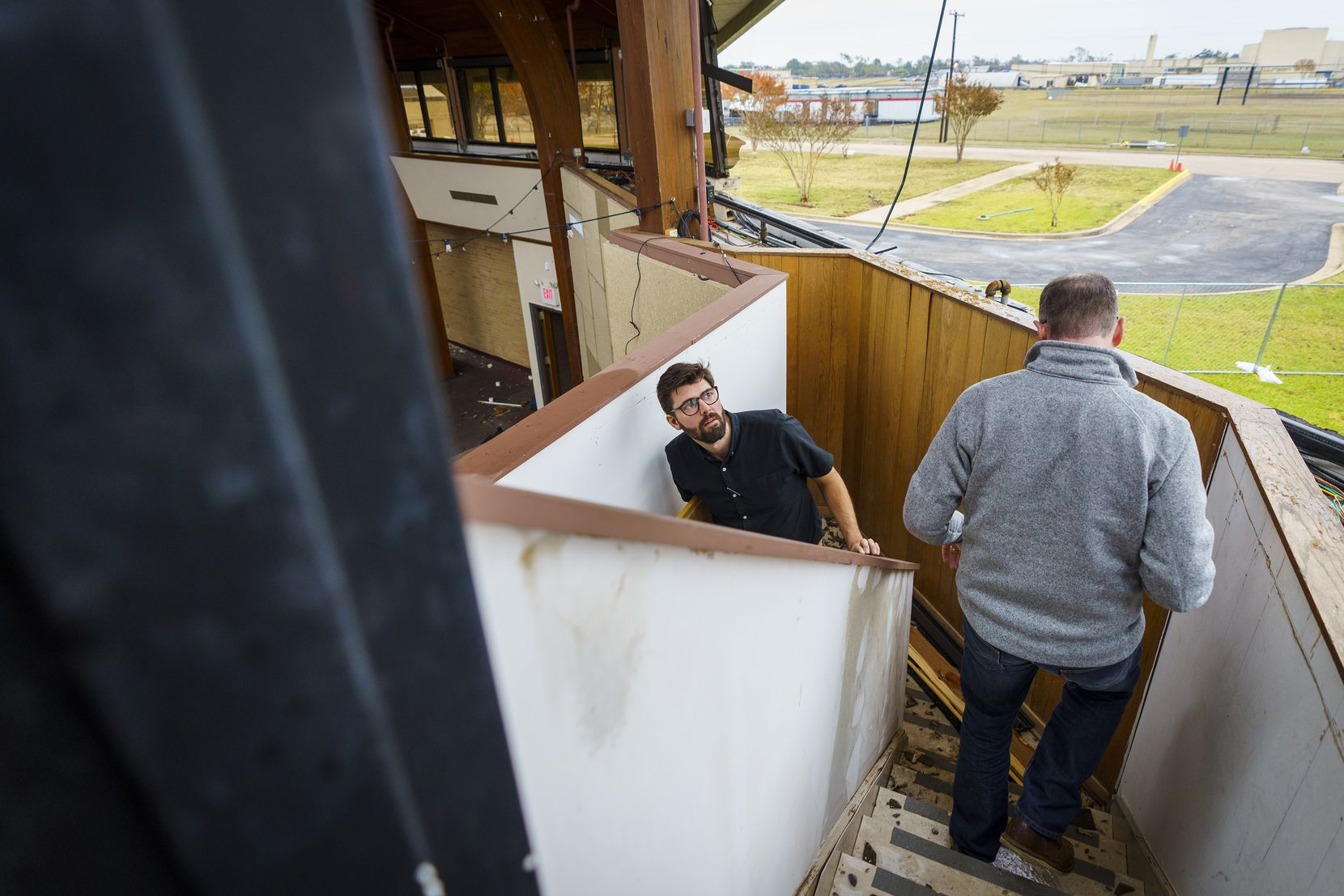Architect Brandon Coates, center, and lead pastor Shea Sumlin survey damage to Northway Church, where the sanctuary will have to come down in coming days.