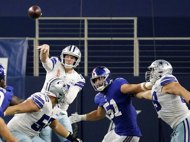 Dallas Cowboys quarterback Andy Dalton (14) throws over the New York Giants defensive line in the fourth quarter at AT&T Stadium Stadium in Arlington, Texas, Sunday, October 11, 2020. The Cowboys defeated the Giants on a last second field goal, 37-34.