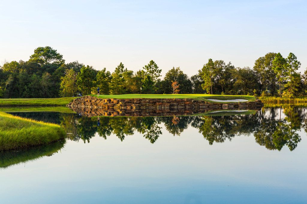 The seventh hole at The Clubs at Houston Oaks in Hockley is a 229-yard par 3 situated on a peninsula. The green is wide but shallow and the prevailing wind is with the players.