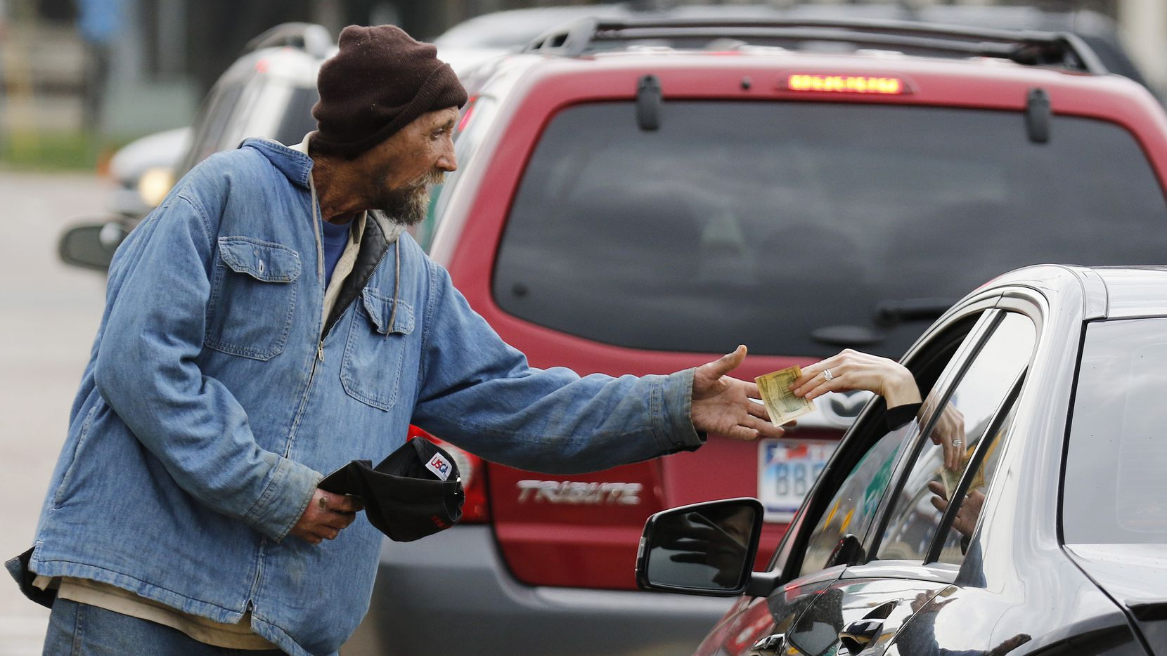 Robert Rushing, 58, works the corner on the service road of I-35 and Oak Lawn on Monday, March 7, 2016. He said he is homeless.
