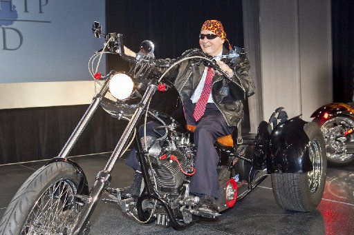 Restaurant legend Norman Brinker rode one of Strokers choppers in May 2009 for a Methodist Hospital benefit one month before his death. The motorcycle was part of his memorial service a month later. (Courtesy of Jerry Bokamper)