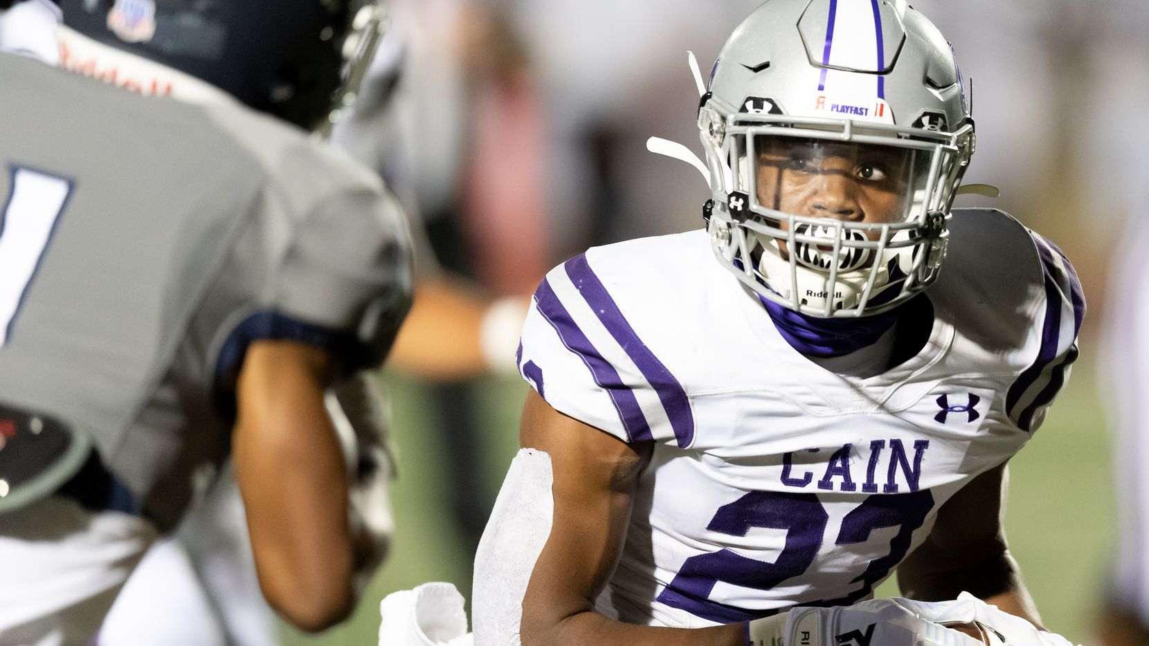 Jaydon Blue (23) of the Klein Cain Hurricanes runs around right end in the first half against the Tomball Memorial Wildcats during a  High School football game on Friday, October 23, 2020 at Tomball ISD Stadium in Tomball Texas.