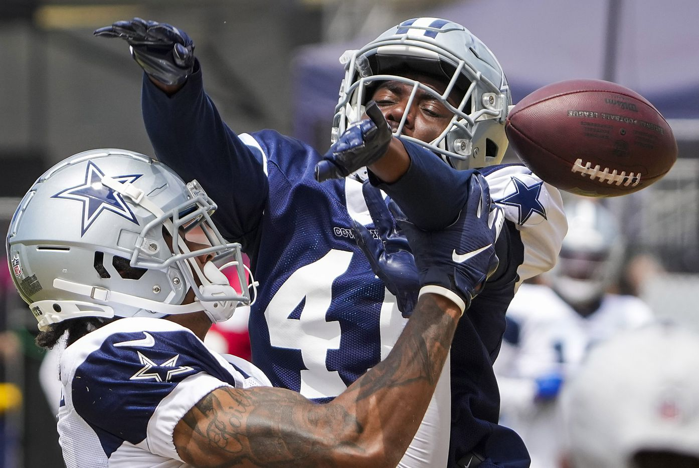 Dallas Cowboys cornerback Reggie Robinson II (41) breaks up a pass intended for wide receiver Osirus Mitchell (14) during a practice at training camp on Wednesday, Aug. 11, 2021, in Oxnard, Calif.